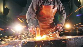Free Inflamed Metal Is Getting Hammered By The Blacksmith. Slow Motion. Stock Images - 157161654