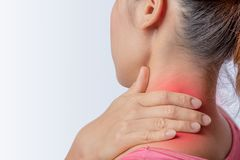 Inflammation left trapezius. Woman pain at trapezius muscle and holding right hand on muscle, swelling and inflammation of left rotator cuff muscle Royalty Free Stock Photo