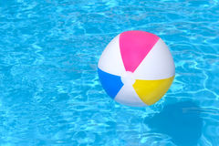 Inflatable ball floating in swimming pool Stock Photo