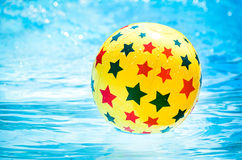 Inflatable ball floating in swimming pool Royalty Free Stock Images