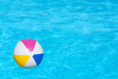 Inflatable ball floating in swimming pool Stock Photos