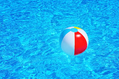 Inflatable ball floating in swimming pool Stock Images