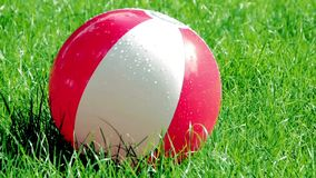 Inflatable ball on grass stock video footage