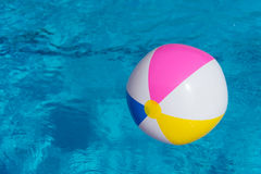Inflatable ball at swimming pool Stock Photo