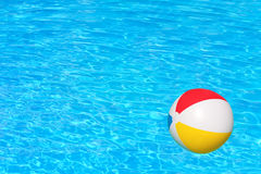 Inflatable ball in swimming pool Stock Photo