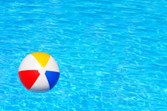 Inflatable ball in swimming pool Royalty Free Stock Image