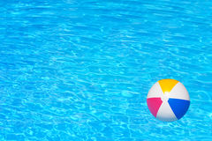 Inflatable ball in swimming pool Stock Images
