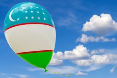 Balloon with the image of the national flag of Uzbekistan, flying through the blue sky. 3D rendering, illustration with copy space royalty free illustration