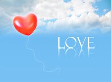 Inflatable balloon in sky and LOVE word Stock Photo