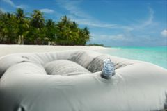 Inflatable bath cushion with valve Royalty Free Stock Photo