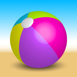 Inflatable beach ball on the beach Royalty Free Stock Image