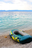 Inflatable blue boat with peddles Royalty Free Stock Photos