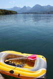 Inflatable boat. Yellow inflatable boat on mountain lake Stock Photos