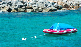 Inflatable boat. Moored Inflatable boat on water Stock Images