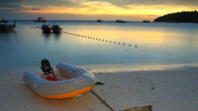 Inflatable boat on beach at twilight Stock Images