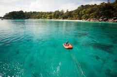 Inflatable boat floating at Similan island Stock Photo