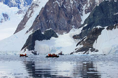Inflatable boat full of tourists, watching for whales and seals, Antarctic Peninsula Stock Photo