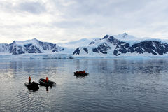 Inflatable boat full of tourists, watching for whales and seals, Antarctic Peninsula Stock Images