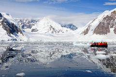 Inflatable boat full of tourists, watching for whales and seals, Antarctic Peninsula Royalty Free Stock Photo