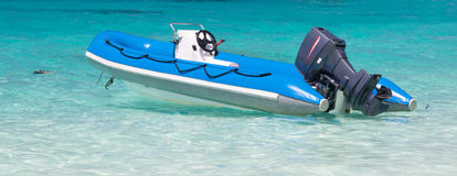 Inflatable boat moored at the blue sea Stock Photo