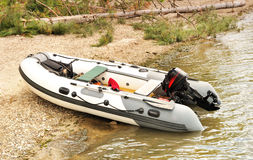 Inflatable boat with a motor. Royalty Free Stock Photography