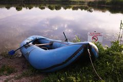 Inflatable boat on the river Bank. Details and close-up stock image