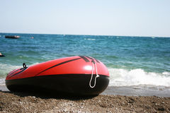 Inflatable boat and sea. Inflatable toy boat and summer seaside Stock Photography