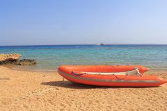 Inflatable boat on the seashore Stock Photo