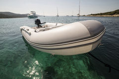Inflatable boat on the water Stock Photos