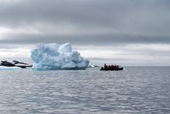 Inflatable boats from an Antarctic cruise ship. Two inflatable boats from an Antarctic cruise ship in front of icebergs Stock Images