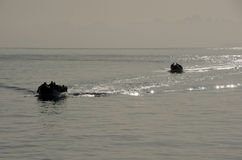 Inflatable boats carrying scuba divers Stock Image