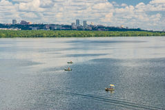 Inflatable boats of fishermen on Dnepr river. Dnepropetrovsk, Ukraine - June 30, 2012: Small inflatable boats of fishermen on Dnepr river in Dnepropetrovsk city royalty free stock image