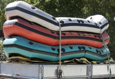 Inflatable dinghy boats, on the shores of Lake Padan, North Wales UK. Inflatable boats, stacked up ready to be driven off on a cars trailer royalty free stock image