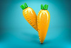 Inflatable carrots on blue background. Concept of artificially m Stock Photography