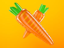 Inflatable carrots on orange background Royalty Free Stock Image