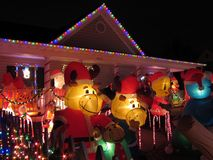 Inflatable Cartoon Characters. Photo of christmas home displaying cartoon characters in alexandria virginia on 12/15/12. This was voted the top favorite in a stock photography