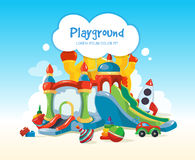 Inflatable castles and childrens hills on playground Stock Images