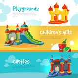 Inflatable castles and childrens hills on playground Stock Photo