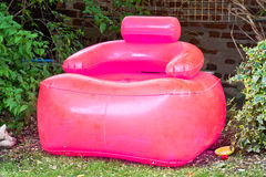 Inflatable chair. A pink inflatable chair in a garden Stock Photos