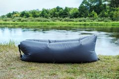 Inflatable chaise longue lamzac on the lake shore in the forest. Inflatable chaise longue lamzac on the lake river shore in the forest royalty free stock images
