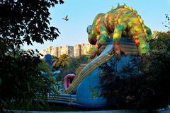 Children`s inflatable attraction in the form of a chameleon in the Park of Odessa. Inflatable children`s attraction in the form of a chameleon in the park of stock photo