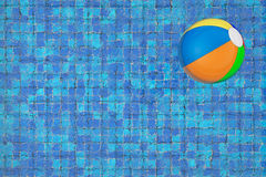 Inflatable colorful ball in a pool Stock Images