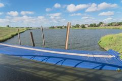 Inflatable dam flood barrier in Irving, Texas, USA. Inflatable dam near a lakeside residential neighborhood and a levee in Irving, Texas, USA. Water filled royalty free stock photos