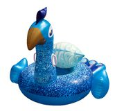 Giant colorful peacock Float. Inflatable float. Inflatable float rubber ring in the shape of a colorful peacock for children and adults, for swimming pools, the royalty free stock image