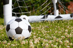 Inflatable football ball and a goal Stock Photo