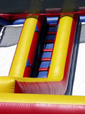 Inflatable Fun. Climbing ladder on inflatable slide for children Stock Image