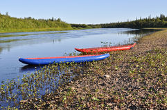 Inflatable kayaks on  shore of the river. Stock Images