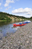 Inflatable kayaks on the shore taiga rivers. Stock Photography
