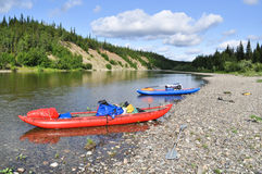 Inflatable kayaks on the shore taiga rivers. Stock Images