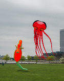 Inflatable Kites. A 150 foot-long inflatable octopus and a large inflatable sea horse hovering over a park in downtown Milwaukee, Wisconsin at a recent kite Stock Photo